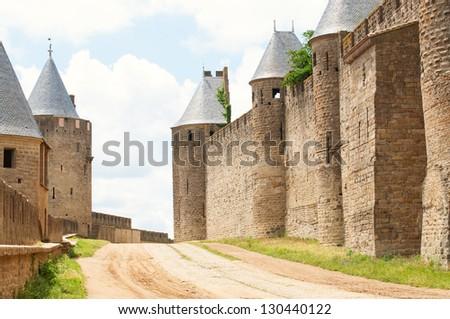 Walls of castle Carcassone - stock photo