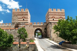 Walls of Constantinople, Istanbul, Turkey. It is a famous landmark of Istanbul. Scenic view of ancient Constantinople's walls with towers and gate. Remains of Byzantine Empire in Istanbul in summer.