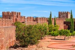 Walls of medieval castle in Silves town, Algarve region, Portugal