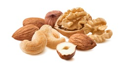 Walnut, almond, hazelnut and cashew nuts isolated on white background. Trail mix. Package design element with clipping path. Full depth of field