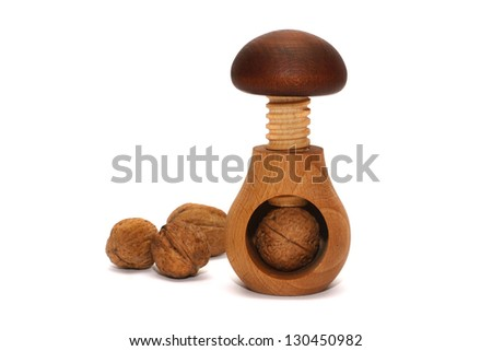 Walnut and nutcracker on the white background