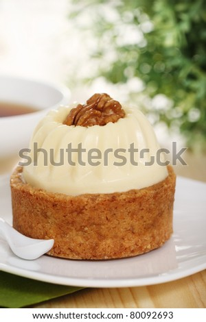 Walnut cake decorated with a cream with coffee