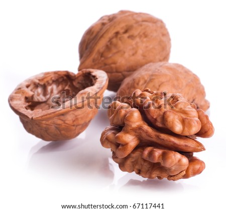 Walnut full both split and a core and an empty shell isolated on a white background