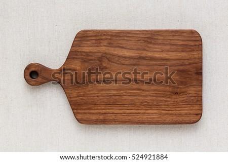 Walnut handmade wood cutting board on the linen Сток-фото ©