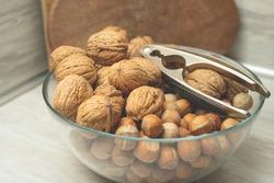 Walnut hazelnut in one bowl with walnut colum