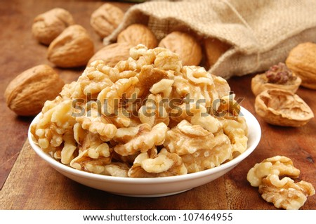 Walnut kernel  in a white bowl