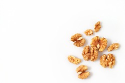 Walnut kernels isolated on white background.