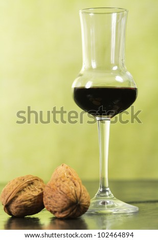 walnut liqueur over ardesia with walnuts