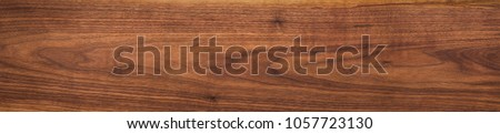 Walnut wood texture. Super long walnut planks texture background. #1057723130