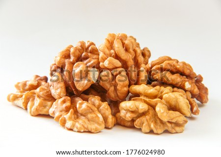 Walnuts, a bunch of peeled walnuts on a white background.