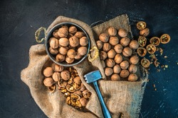 Walnuts. Beautiful composition with wallnuts on the sackcloth. Nuts on the table. Flat lay.