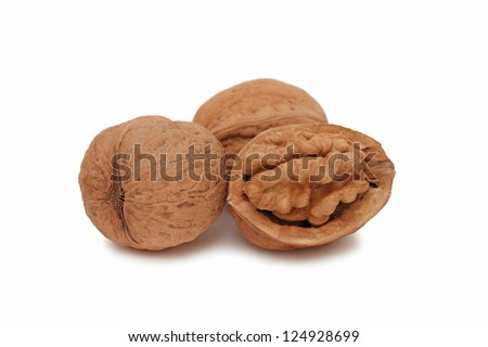 Walnuts (full and cracked) isolated on white background