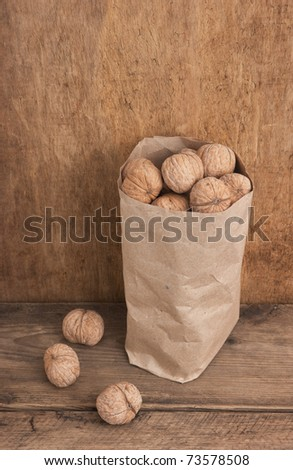 walnuts in a brown kraft paper bag