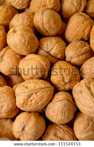 Walnuts in shells, one upon the other