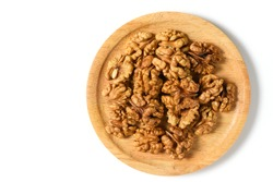 Walnuts in wood plate  isolated on white background. healthy nuts concept. Walnuts are an excellent source of antioxidants and including LDL cholesterol, which promotes atherosclerosis.