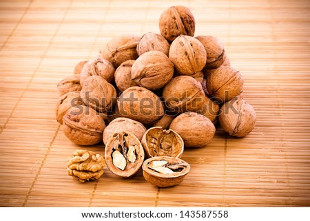 Walnuts isolated on wood background textures - stock photo