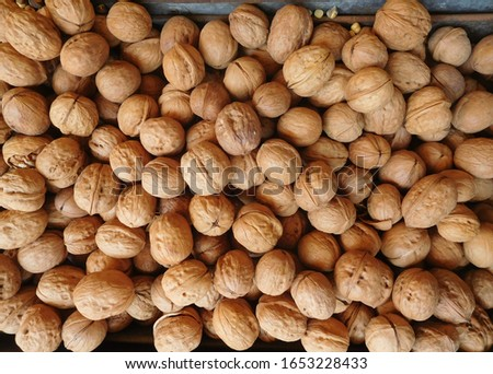 Walnuts laid on a vendor's stall at the local farmer's market.
