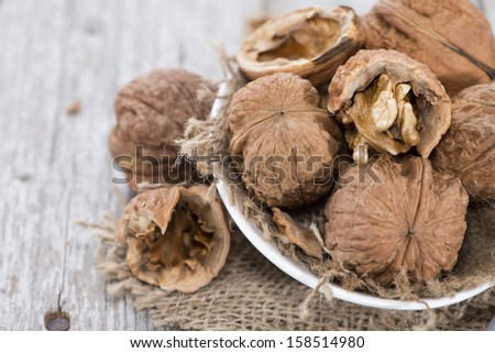 Walnuts (macro shot) on vintage wooden background