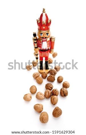 Walnuts with a nutcracker figure