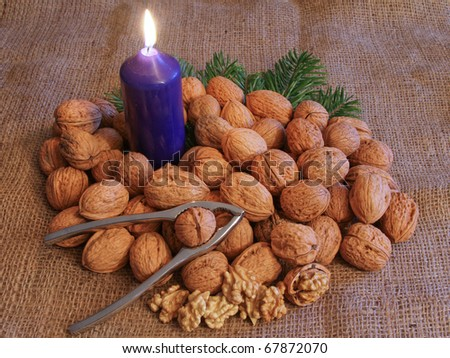 walnuts with candle and nutcracker
