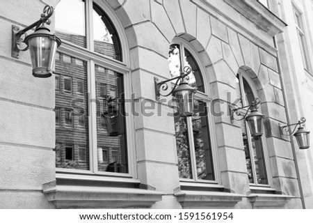 Wanderlust and city dust. Old building architecture. House facade with windows and lanterns. Architectural structure. Building and architecture. Town architecture. Architecture and urban development.