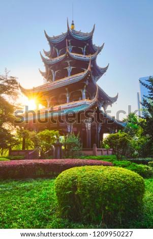 Wangjiang Pavilion (Wangjiang Tower) in Wangjianglou Park on sunrise with sun. Chengdu, Sichuan, China