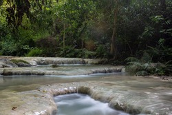 Wangkanlueang Waterfall Oasis of Lopburi in Thailand,cascade in tropical rainforest with rock and turquoise blue pond at National Park, Wang Kan Lueang Waterfall Arboretum