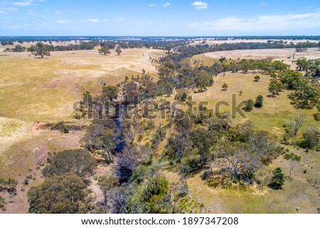 Wannon River flowing through rolling hills in Victoria, Australia - aerial view Stock photo ©