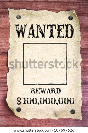 Wanted poster on wood background