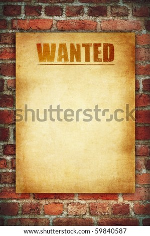 wanted vintage sign on the red brick wall