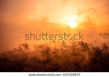 Stock Photo War Concept. Military silhouettes fighting scene on war fog sky background, World War Soldiers Silhouettes Below Cloudy Skyline At night. Attack scene. Armored vehicles. Tanks battle. Decoration