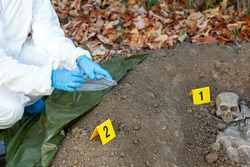 War crime investigation. Forensic science specialist at work.