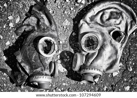 War Results. Black and white masks torn with broken glass. Black and white photograph.