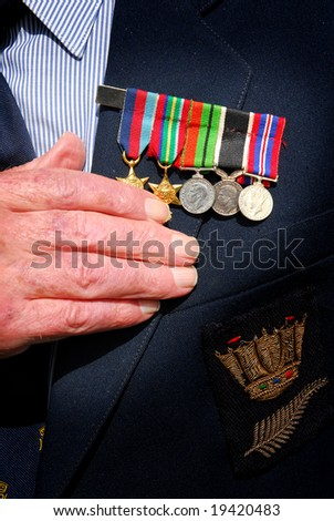 War veteran with hand over heart and war medals