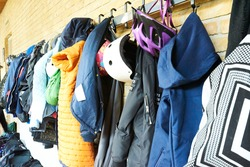 wardrobe rack with children clothes at school