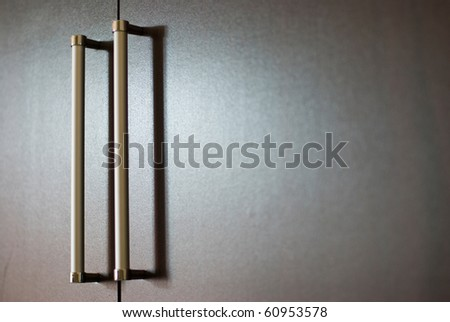 wardrobe with silver handles under soft light