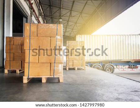 Warehouse and Logistics, Courier cargo transport shipment goods . Stack of cardboard boxes on wooden pallet for load into the truck container trailer.