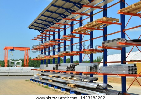 Warehouse Cantilever Racking Systems for storage Aluminum Pipe or profiles. Pallet Rack and Industrial Warehouse Racking. Steel profiles, sheet metal build-profile - Image