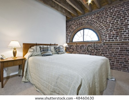 warehouse conversion bedroom with exposed brick work
