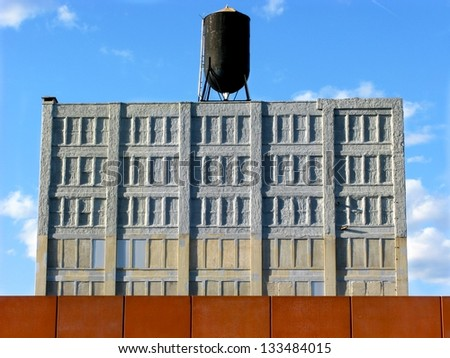 Warehouse converted for storage with water tank and deep blue sky in DUMBO, Brooklyn