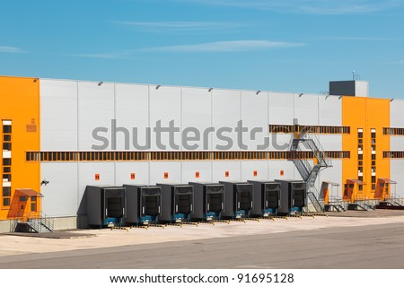 Warehouse. Empty loading docks. - stock photo