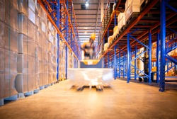 Warehouse forklift working in large warehouse