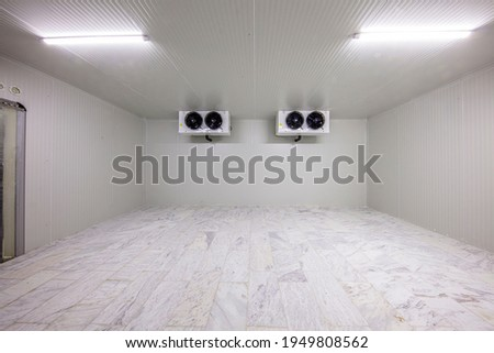 Warehouse freezer, Cold storage. Refrigeration chamber for food storage. an empty industrial room refrigerator with four fans. Stock photo ©