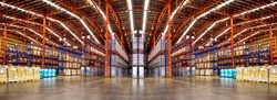 Warehouse industrial and logistics companies. Commercial warehouse. Huge distribution warehouse with high shelves. Low angle view.