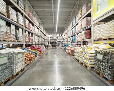 Warehouse industrial premises for storing material. Warehouse of building materials in industiral store. Concept logistics, transport #1226889496