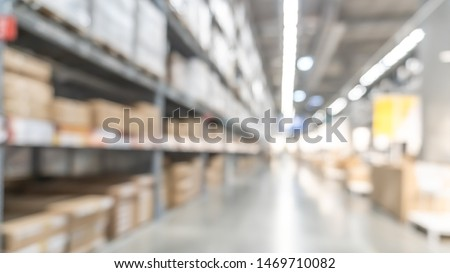 Warehouse industry blur background with  logistic wholesale storehouse, blurry industrial silo interior aisle for furniture merchandise inventory and wood material, construction supplies big box store