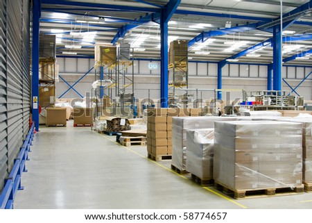 warehouse interior and pallets with cardboard
