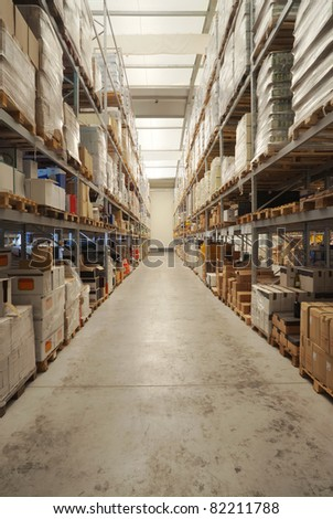 Warehouse interior, classified beverages packs on the shelves.