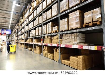 Warehouse interior with staff.
