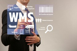 Warehouse management system concept. Man working with virtual screen